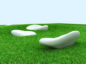 Big white stones on grass — Stock Photo