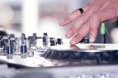 Turntable disc jockey with human hand — Stock Photo