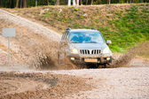4x4 making big splash in mud — Stock Photo