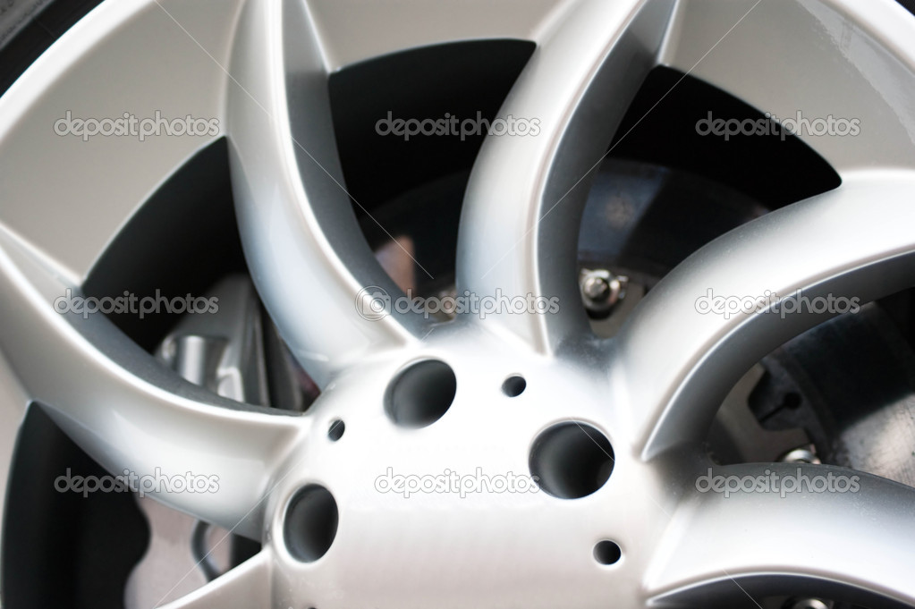 Detail view of a sports car?s alloy wheel.  Stock Photo #1079190