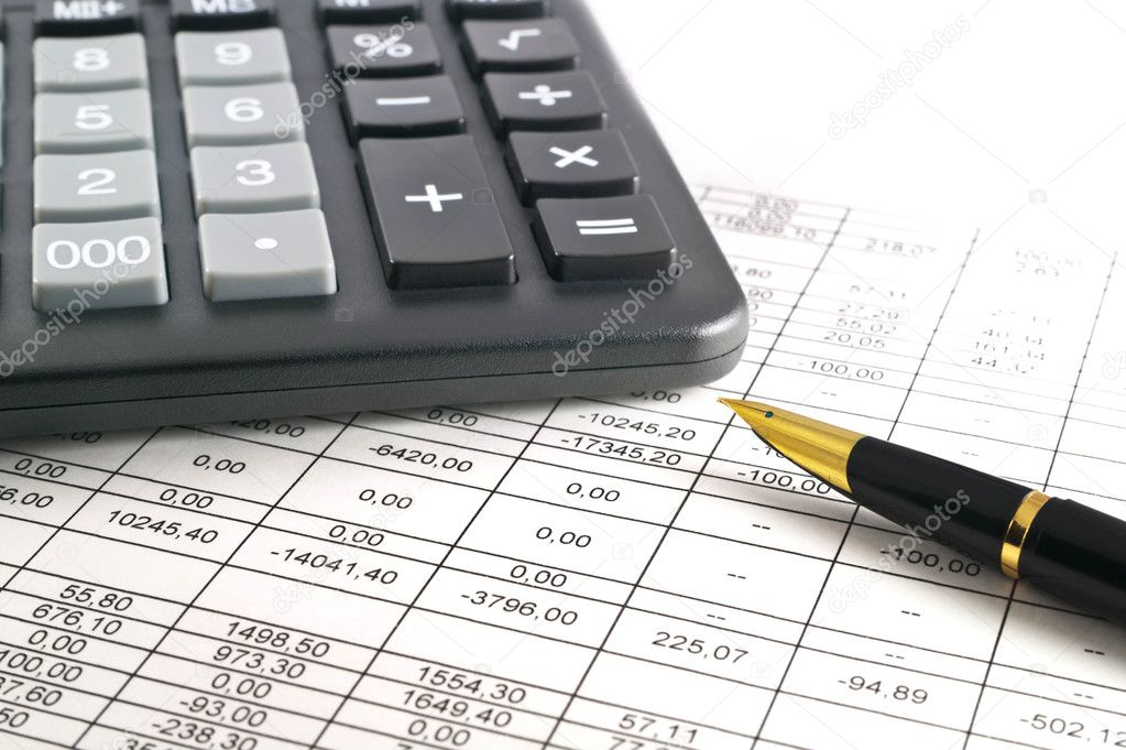 A calculator, pen, and financial statement.  Stock Photo #2257777