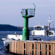 Stock Photo: Small lighthouse and boat
