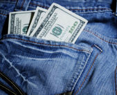 Dollars in the jeans pocket — Stock Photo