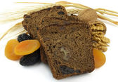 Black bread with fruit — Stock Photo