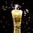 Beer glass with water splashes — Stok fotoğraf