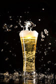 Beer glass with water splashes — Stock Photo