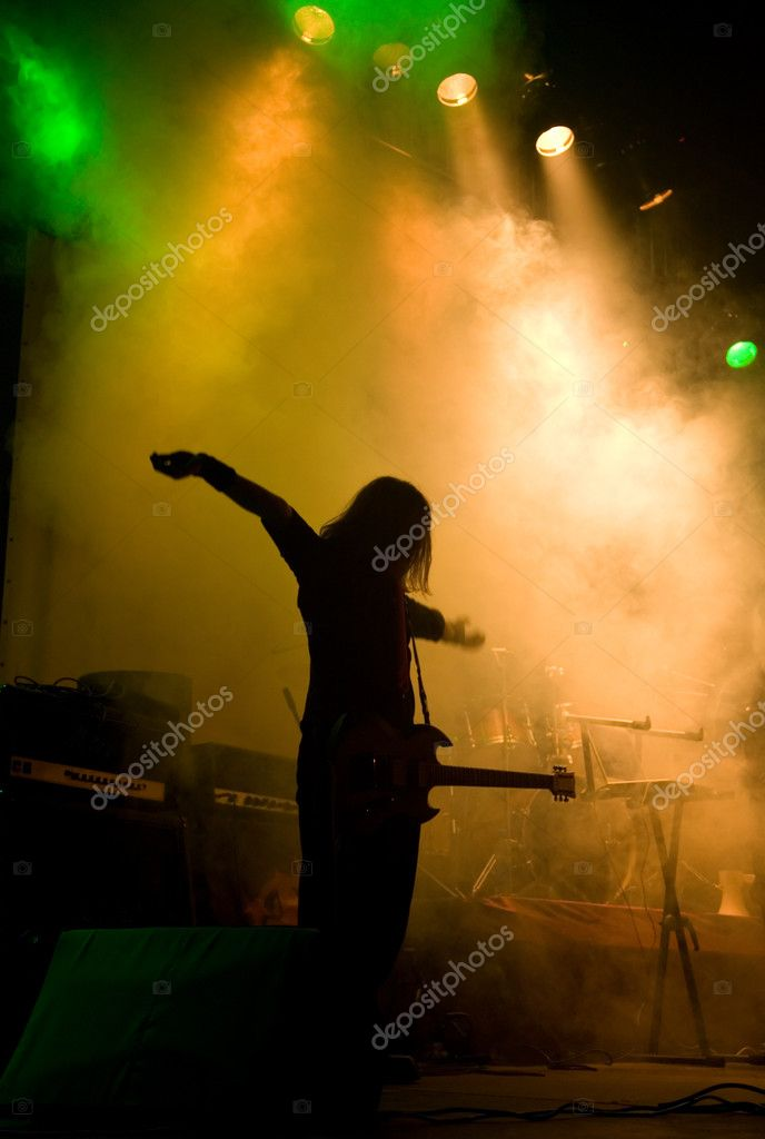 Unrecognizable musician on the stage, laser show and smoke  — Stock Photo #1071896