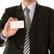 Businessman holding blank business card — Stock Photo
