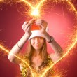 Attractive girl drawing heart — Stock Photo