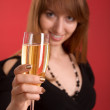 Girl with champagne, focus on glass — Stock Photo