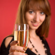 Cheers! Girl with champagne, focus on gl — Stock Photo