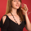Winking girl with champagne glass — Stock Photo