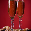 Champagne glasses with pearl necklace — Stock Photo
