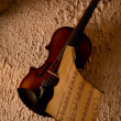 Stock Photo: Old violin with burnt music sheet