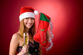Beautiful girl with Christmas stocking — Stock Photo