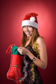 Happy girl with Christmas stocking — Stock Photo