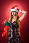 Disappointed girl with Christmas stockin — Stockfoto
