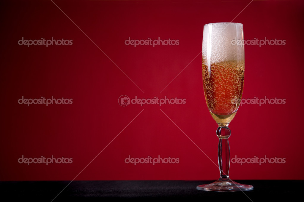 Champagne glass over red background, lot of copy-space  — Stock Photo #1099354
