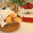 Table setting with bread basket and wine - Stock Photo