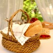 Table setting with bread basket with win - Stock Photo