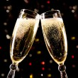 Two champagne glasses making toast - Stock Photo