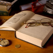 Still-life with books and glasses — Stock Photo