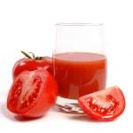 Juicy tomatoes and tomato juice — Stock Photo