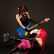 Sexy rock girls with bass guitar — Stock Photo