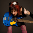 Sensual rock girl with bass guitar — Stock Photo