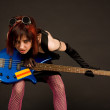 Rock girl with bass guitar — Stock Photo