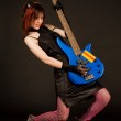 Attractive girl playing bass guitar — Stock Photo