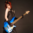 Rock girl with blue bass guitar — Stock Photo