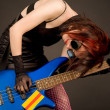 Crazy musician with bass guitar — Stock Photo #1108385