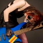 Crazy musician with bass guitar — Stock Photo