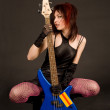 Attractive girl with bass guitar — Stock Photo
