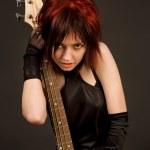 Sensual girl with bass guitar — Stock Photo
