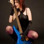 Sensual girl holding guitar — Stock Photo