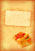 Vintage wallpaper with gift box — Stock Photo