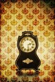 Vintage clocks on grungy background — Stock Photo