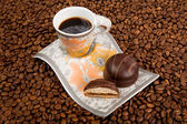 Coffee cup with sweets — Stock Photo
