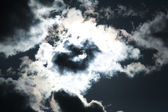 Moon and clouds on the dark sky — Stock Photo