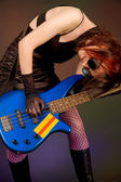 Crazy musician with bass guitar — Stock Photo