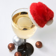 Royalty-Free Stock Photo: Glass of champagne in the Santa hat