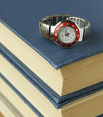 Stack of books and watches — Stock Photo