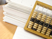 Documents end abacus — Stock Photo