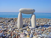 Stone gate on the beach — Stok fotoğraf