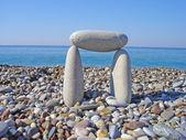 在海滩上的石头口门 — 图库照片
