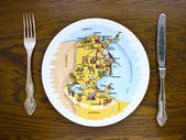 Plate with a map — Foto de Stock