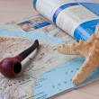 Starfish and the pipe on the geographica — Stock Photo