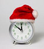 El reloj en el sombrero de santa claus — Foto de Stock